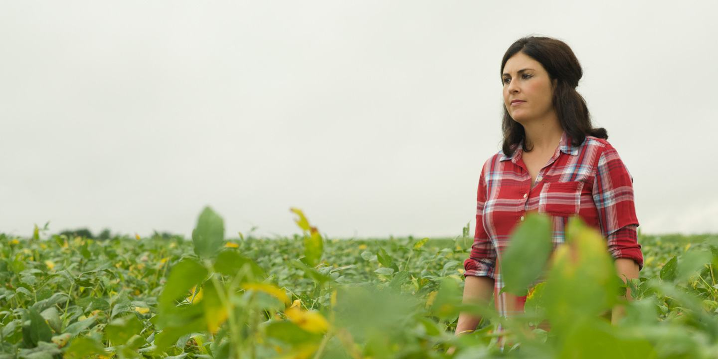 Female farmer standing in her crop field
